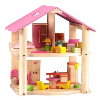 Pequeña casa rosada con...